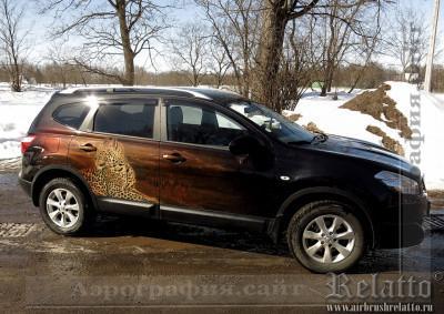 гепард на Nissan - новый рисунок поверх старого