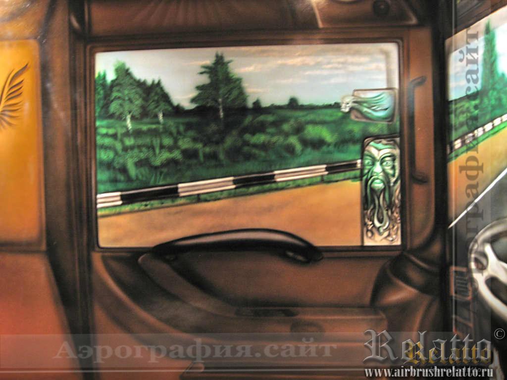 """Левая дверь кабины.  Долго думали над тем, что изобразить в зеркалах- и сделали так, что водитель устал """"до чертиков"""" и вид из лобового стекла (см) показывает ему поворот на паркинг- """"заезжай  отдохнуть душой и телом""""."""